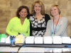 From left, Stacy Cabela, Nancy Nathenson, and Nicole Meyer welcomed attendees at the registration desk.