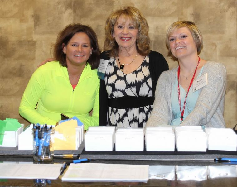 From-left-Stacy-Cabela-Nancy-Nathenson-and-Nicole-Meyer-welcomed-attendees-at-the-registration-desk